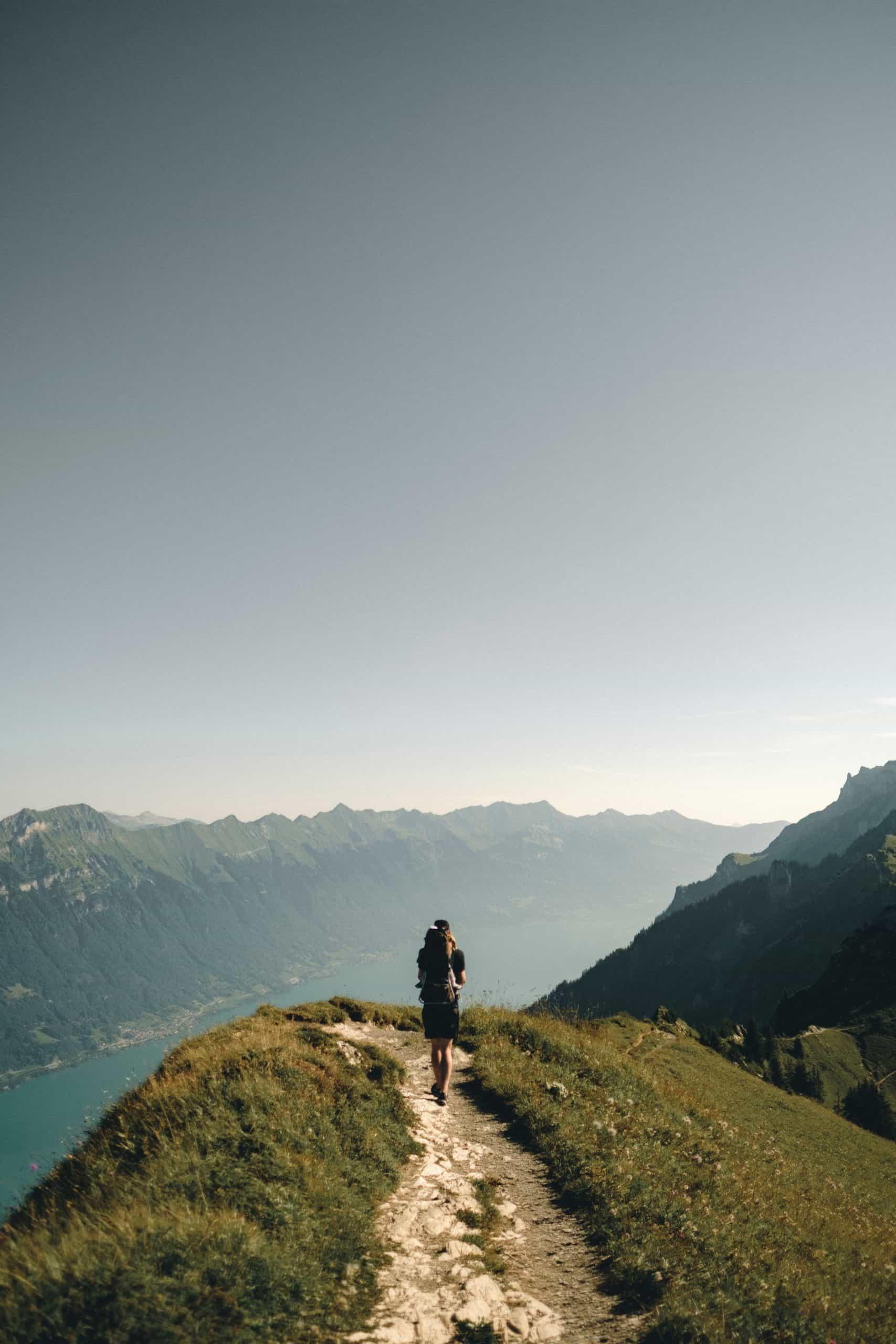 Person trekking through mountains